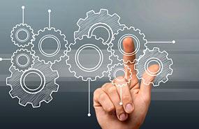 Unternehmensvermittlung-Finger-tippt-auf-Zahnraeder